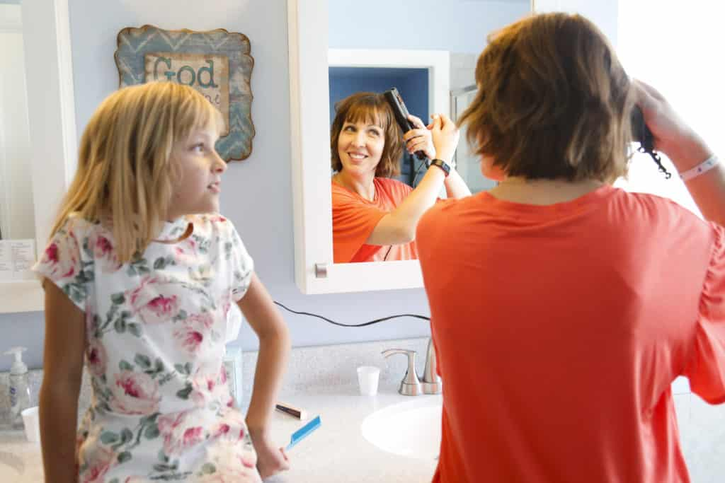 Misty Marsh and daughter doing hair in bathroom