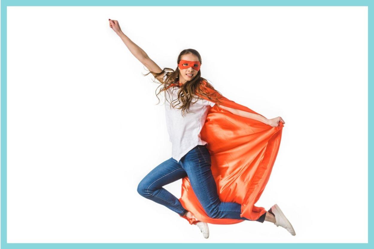 Woman in superhero cape