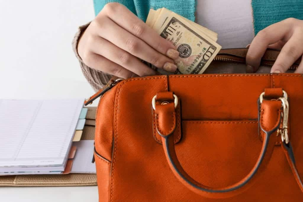 woman pulling money out of purse