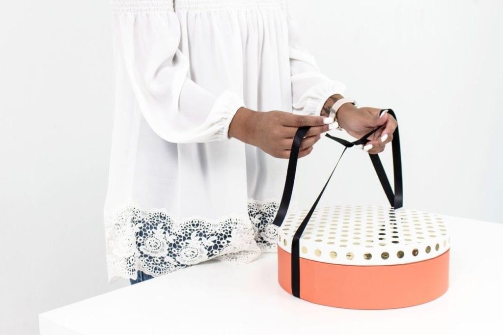women opening a gift